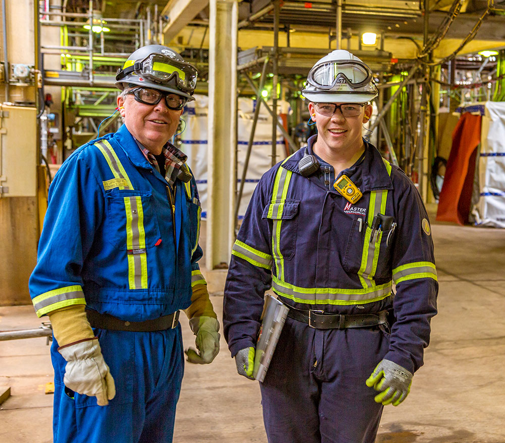 Two Lorneville Workers with Safety Goggles
