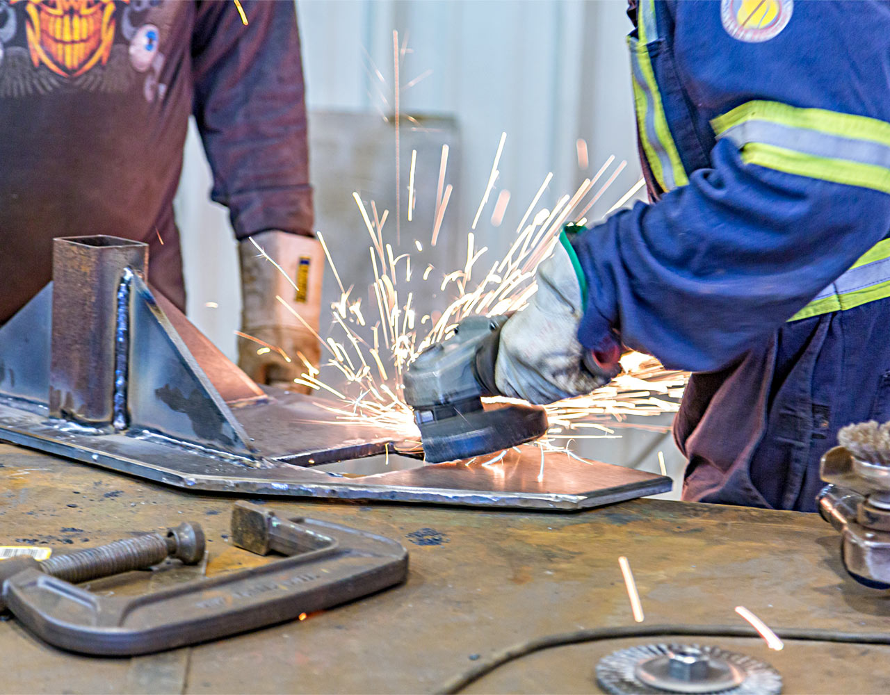 Two Men's Hands Welding With Sparks