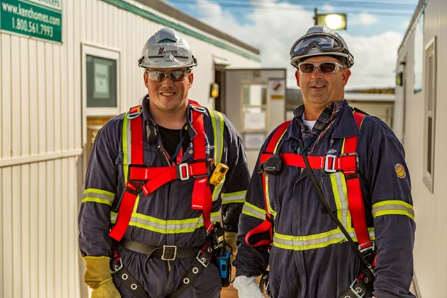 Men In Safety Gear Smiling