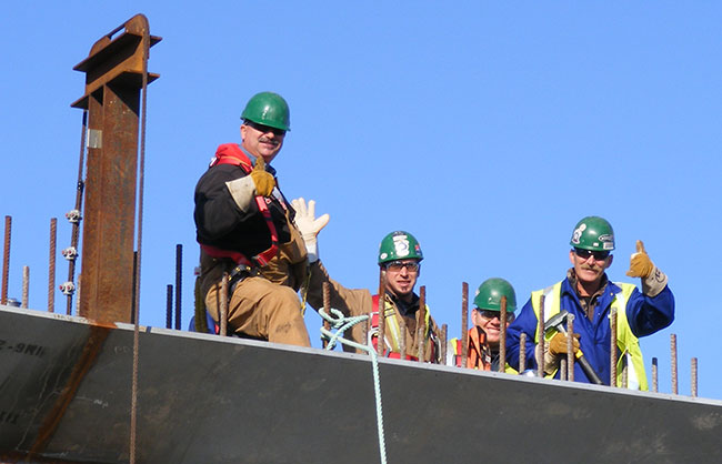 Lorneville Tradespeople Waving from Roof